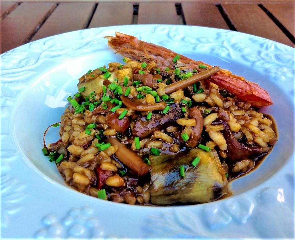 arroz paella alcachofas y pulpo